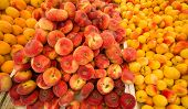 stock photo of stall  - Fresh apricots and peaches on a street market stall - JPG