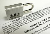 stock photo of social-security  - Social Security lock on top of paperwork - JPG