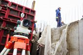 stock photo of geodesic  - Surveyor equipment level theodolite outdoors at construction site - JPG