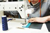 picture of tailoring  - male tailor working with sewing machine and cloth in workshop - JPG