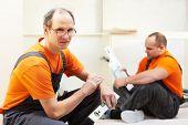 picture of assemblage  - Craftsman kitchen carpenter workers at kitchen furniture set installation service work - JPG