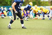 stock photo of football helmet  - American football player with helmet in hand watching the game  - JPG