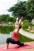 stock photo of yoga instructor  - Female yoga instructor doing exercises alone outoors - JPG