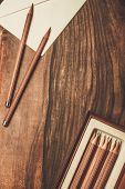 stock photo of charcoal  - Luxurious charcoal drawing pencils on a wooden table  - JPG