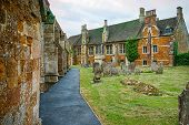 image of cemetery  - Footpath by side of church past a cemetery - JPG
