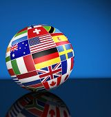 foto of flags world  - Travel services education and international business management concept with a globe and international flags of the world on blue background with copy space - JPG