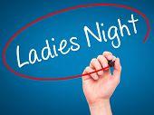 image of ladies night  - Man Hand writing Ladies Night with black marker on visual screen - JPG