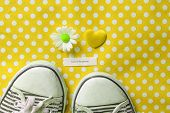 foto of pov  - a motivational message next to some pumps a love heart and a daisy on yellow polka dots - JPG