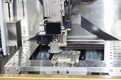image of ferrous metal  - wire cut machine cutting high precision mold parts - JPG