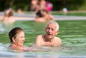 image of hot couple  - Senior couple enjoying sun and holiday in the pool with hot water - JPG