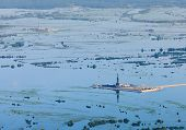 stock photo of  rig  - Oil rig in flooded area near great river - JPG
