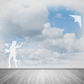 stock photo of kites  - Silhouette of teenager girl playing with flying kite - JPG