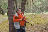 pic of rifle  - Outdoor portrait of senior ranger with rifle - JPG