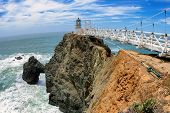 pic of lighthouse  - The bridge to Lighthouse on the rock - JPG