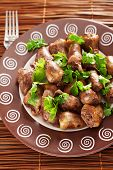 picture of cilantro  - Duck Hearts in butter with cilantro shot from above