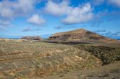 stock photo of volcanic  - Volcanic landscape of the island of Lanzarote Canary Islands Spain - JPG