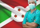 picture of burundi  - Surgeon with flag on background  - JPG