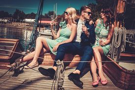 picture of yacht  - Stylish wealthy friends having fun on a luxury yacht  - JPG
