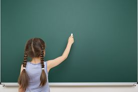 stock photo of schoolgirl  - Schoolgirl near the school board - JPG