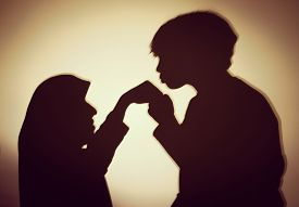 stock photo of muslim  - Silhouette of Muslim woman with her son - JPG