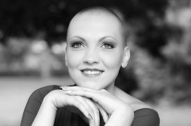 stock photo of chemotherapy  - Happy and young cancer survivor after successful chemotherapy - JPG