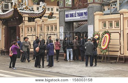 Hanoi, Vietnam - Mar 15, 2016: Vietnamese people garthering to prepare to take a funeral visit to the passed away relative at the funeral house on Phung Hung street.