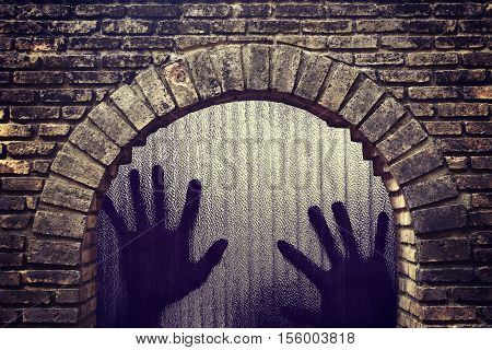 Silhouette of a hand the expression to be imprisoned in tunnel