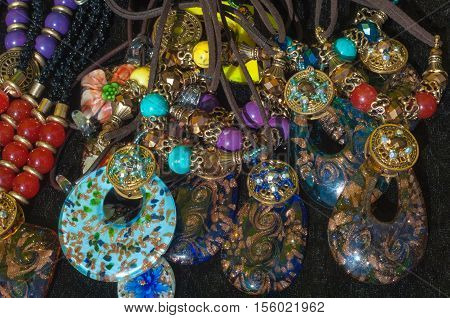 bead chaplet beading. bead chaplet beading. a small piece of glass stone or similar material typically rounded and perforated for