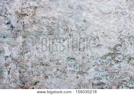 uneven texture and background of the old plastered surface of an ancient wall