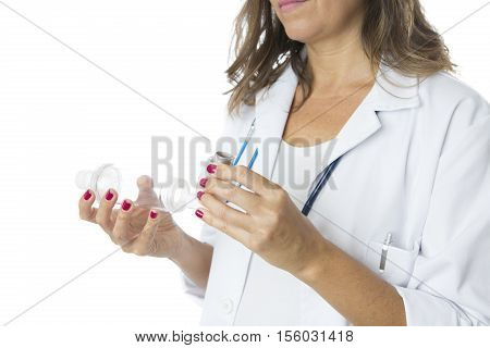 Female doctor is inserting a pressurized cartridge inhaler into an inhalation chamber on a medical demonstration - Cropped view - Isolated on a white background