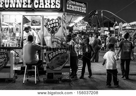 Montgomery Alabama USA-- October 29 2016: Business is good with food vendors at the Alabama National Fair as several people stand in line to get something to eat.