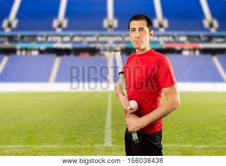 field hockey player posing wing camera in a stadium