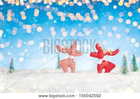 Home made traditional cloth caribou decoration in snow. Concept of miniature and winter