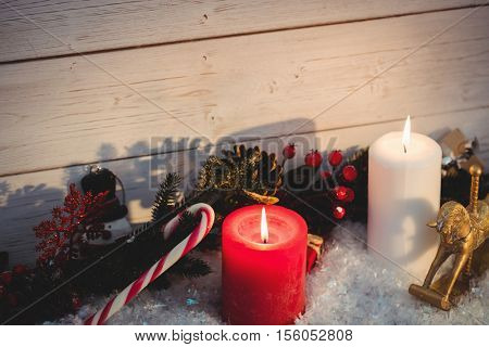 Christmas decorations against wooden wall during christmas time