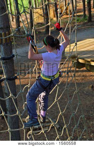 Girl Climbing Cargo Net