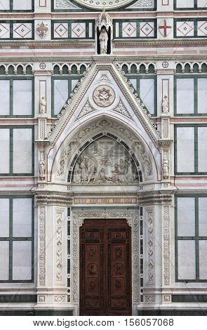 Portal of the Holy Cross Basilica in Florence, Italy
