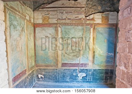 POMPEII ITALY - OCTOBER 4 2012: The archaeological site preserved a lot of painted interiors of villas stores and temples on October 4 in Pompeii.
