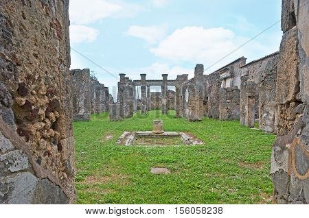 The ruins of the House of Pansa with preserved colonnades and walls Pompeii Italy.