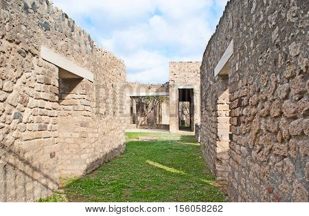 The stone walls of the ancient roman villas preserved in Pompeii Italy.