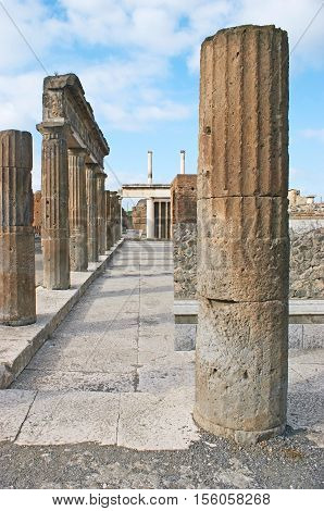 The ruins of Apollo Temple with preserved stone columns Pompeii Italy.
