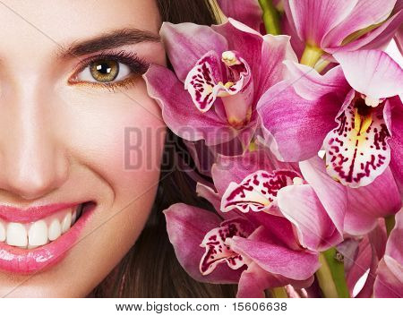 Woman with pink orchids