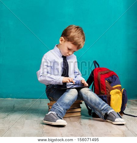 Child Playing Games On A Touch Pad.
