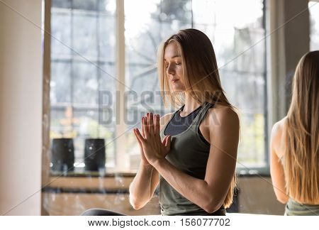 Woman Doing Yoga Exercises In Gym, Sport Fitness Girl Sitting Lotus Pose Meditation Relaxation