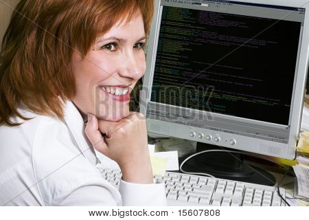Professional woman programmer at her work place
