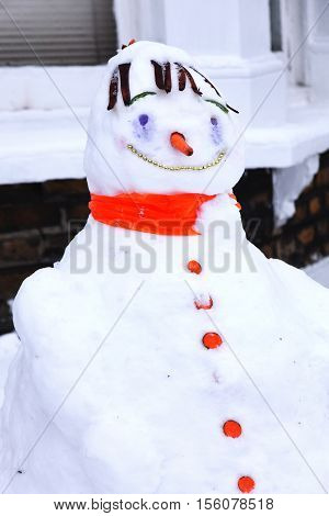 Snowman with a carrot nose and a huge fun smile