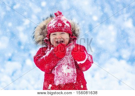 Baby Playing With Snow In Winter.