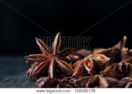 Star Anise Seeds On The Wooden Table. Black Background