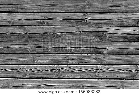 Weathered Black And White Log House Wall.
