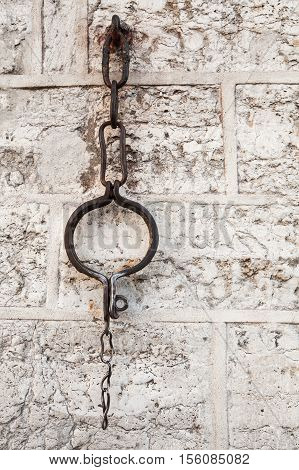 Medieval shackles mounted in old stone wall on Town Hall square in old Tallinn Estonia