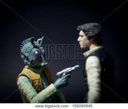 Recreation of the scene with Hasbro action figures from Star Wars: A New Hope where bounty hunter Greedo confronts Han Solo in the Mos Eisley cantina to collect a bounty for Jabba the Hutt.